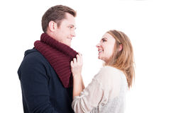 Woman arranging man's autumn casual neckcloth. And smiling like being comfy isolated on white background Royalty Free Stock Photos