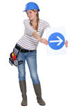 Woman with arrow sign Stock Images