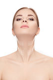Woman with arrows on face over white background. neck lifting co Royalty Free Stock Photography