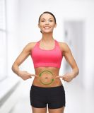 Woman with arrows on her stomach Royalty Free Stock Photography