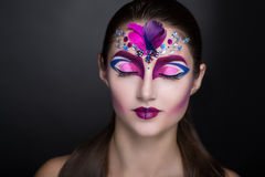 Woman with art make up Stock Images