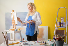 Woman in art studio painting an artistic  picture Stock Images