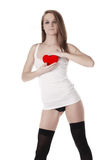 Woman and artificial red heart. Young beatiful woman holding artificial red heart Royalty Free Stock Photo