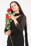 woman with artificial roses Stock Image