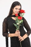 Woman with artificial roses Stock Images