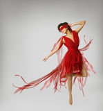 Woman Artist Dancing in Red Dress, Girl with Band on Eyes Stock Image