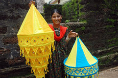 A woman artist displaying lampshed. Stock Photography
