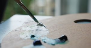 Woman artist draws picture on canvas in home studio. Colseup shot of young woman artist draws picture on canvas in home studio stock footage