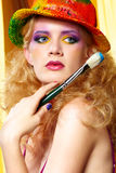 Woman  artist with paintbrush Stock Photography