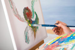 Woman artist painting a picture Royalty Free Stock Photo