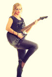 Woman artist player with electric guitar. Royalty Free Stock Photography