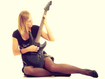 Woman artist player with electric guitar. Stock Photo