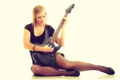 Woman artist player with electric guitar. Royalty Free Stock Image