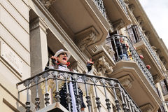 Woman artist sings on her balcony of La Rambla (famous avenue) Royalty Free Stock Images