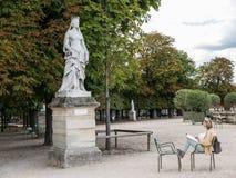 Woman artist sketches statue in Jardin de Luxembourg Stock Image