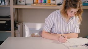 Woman artist smartphone sketching creating artwork. Woman artist looking at smartphone screen sketching. Neat workplace. Young blonde female focused creating stock footage