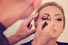 Woman in artist studio geting make up  on Stock Photo