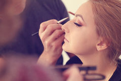 Woman in artist studio geting make up  on Stock Photos