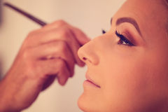 Woman in artist studio geting make up  on Royalty Free Stock Photography