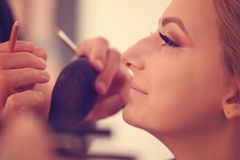Woman in artist studio geting make up  on Stock Image