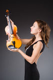 Woman artist with violin Stock Images