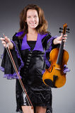Woman artist with violin Stock Photography