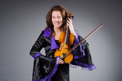 Woman artist with violin Stock Photos
