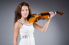Woman artist with violin Stock Photo