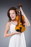 Woman artist with violin Royalty Free Stock Image