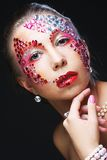 Woman with artistic make-up. Luxury image. Royalty Free Stock Photo