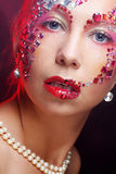 Woman with artistic make-up. Luxury image. Royalty Free Stock Images