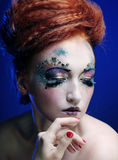 Woman with artistic make-up Stock Photography