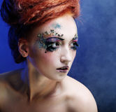 Woman with artistic make-up Stock Photos