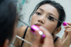 Woman as applying makeup Stock Image