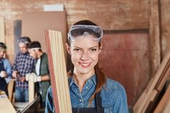 Woman as apprentice of carpentry Stock Photo