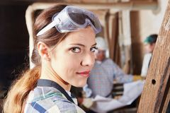 Woman as apprentice for carpentry Royalty Free Stock Photo
