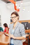 Woman as businesswoman in startup. Woman as businesswoman founder in startup office holding tablet computer Royalty Free Stock Photos