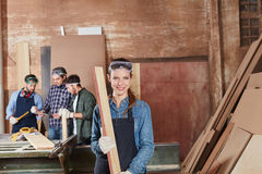 Woman as carpentry apprentice. Working with wood Stock Photography