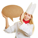 Woman as chef cook with speech bubble Stock Photo