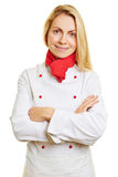 Woman as cook with her arms crossed Stock Photo