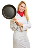 Woman as cook holding frying pan Royalty Free Stock Photography