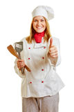 Woman as a cook holding thumbs up Royalty Free Stock Photography