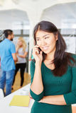 Woman as founder calling with cell phone Stock Image