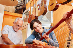 Woman as luthier repairs harp Royalty Free Stock Photo