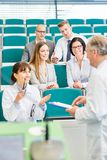 Woman as medical school student. In state examination test royalty free stock photos