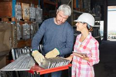Woman as metalworker in apprentice lesson. With blue collar worker as instructor Royalty Free Stock Image