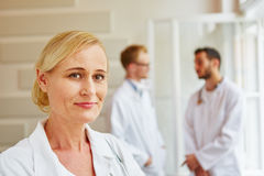Woman as physician. With her team at hospital Royalty Free Stock Photography