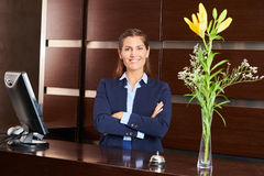 Woman as receptionist in hotel lobby Royalty Free Stock Images