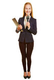 Woman as reporter with microphone. Smiling young woman as reporter with microphone and clipboard Royalty Free Stock Photo
