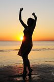 Woman as silhouette by the sea Royalty Free Stock Photography